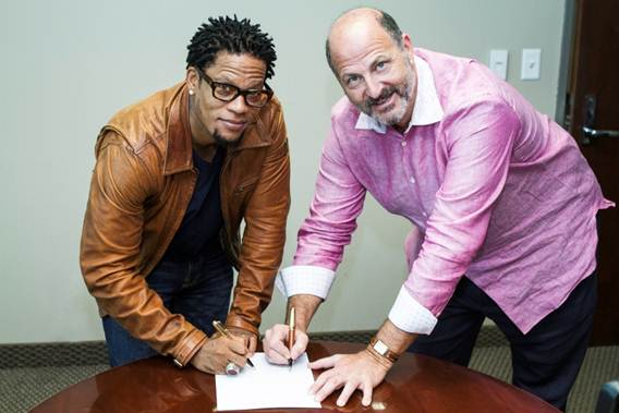 Photo Credit: Rance Elgin (left to right D.L. Hughley with David Kantor, REACH Media CEO)